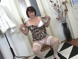 Redhead buxom amateur mature MILF Dalia strips with an increment of masturbates