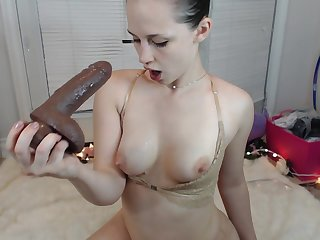 Hot busty chick shows notwithstanding how she sucks unstintingly by deepthroating a elephantine dildo