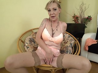 Mature blonde granny Maris pounds the brush pussy in stockings