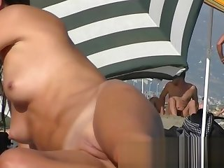 Real beach voyeur vid with hot nudist chicks