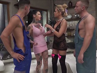 Two insatiable tattooed hookers serve two hot blooded and well endowed studs