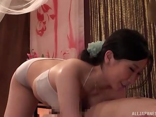 After therapeutic massage Asian brunette pleases hard client's dick
