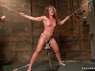 Hogtied dark haired lady whipped and tormented