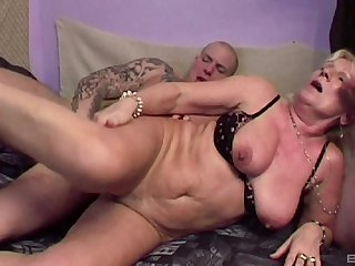 Mature blonde Lizzy is between young dudes during a wild threesome