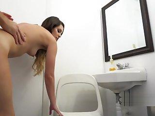 Cute brunette bangs in teach restroom