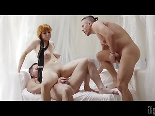 Redhead gets shared by two females and jizzed on her big tits