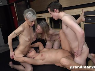 Matures share a cock together in merciless group XXX