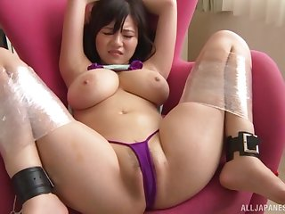 Well-endowed Japanese girl Natsu Kimino gets licked and poked with toys