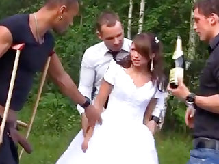 Russian strife = 'wife' enjoys an interracial gang-bang into the open air